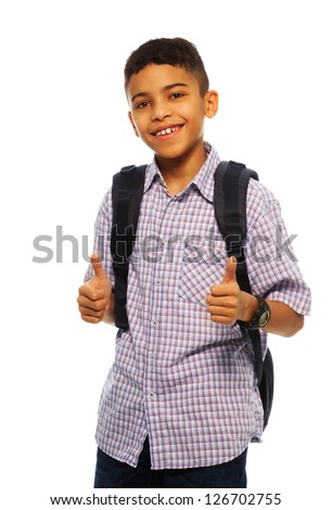 Black boy twelve years old smiling with thumbs up gesture and backpack - stock photo