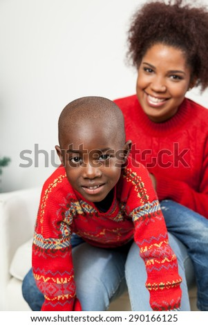 Black boy with his mom - stock photo