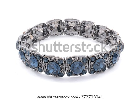 black bracelet with blue stones on the white background - stock photo