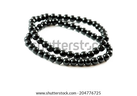 Black bracelets isolated over white background.