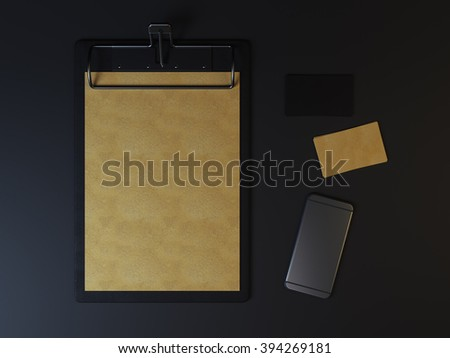 Black branding elements. Mockup of empty menu in clip board. Craft style yellow and black cards with phone - stock photo