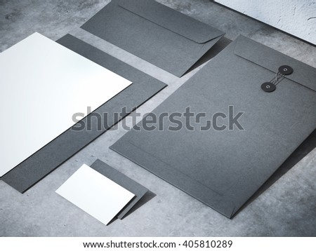 Black branding mockup on a concrete floor with shadows. 3d rendering