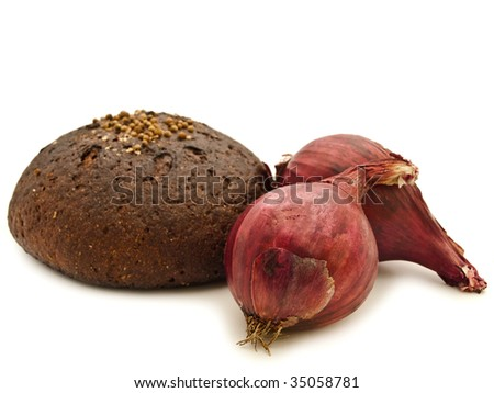 black bread and red onion over white background