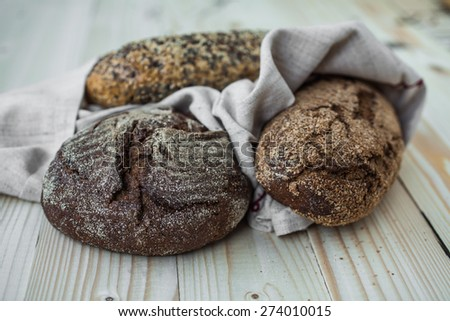 black bread, bread with sunflower seeds and bread with bran - stock photo