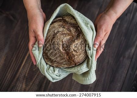 black bread in hands  - stock photo