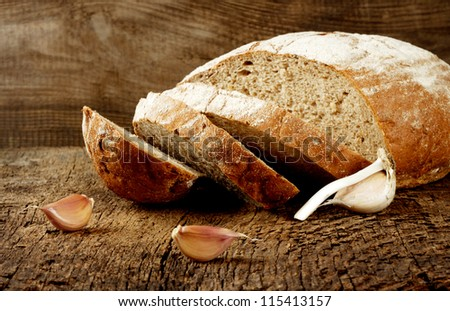 Black bread with garlic on a wooden background