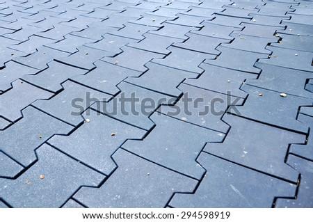 Black brick are paving on the Play Ground. - stock photo