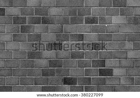 Black brick stone wall seamless background and texture - stock photo
