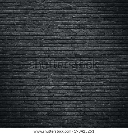 Black brick wall - stock photo