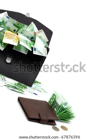 Black briefcase with money on a white background