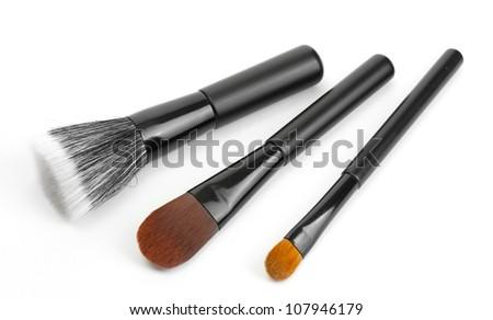 black brushes for make-up isolated on white - stock photo