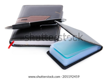 Black business card holder notebook and pen close-up - stock photo