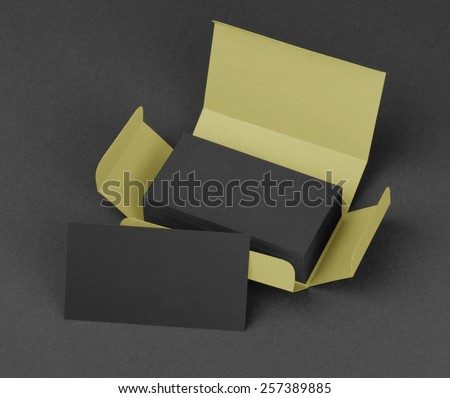 Black business cards in the beige box - stock photo