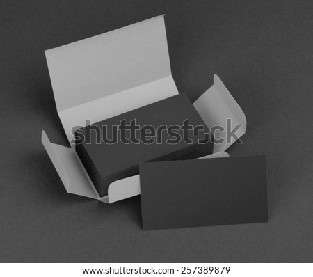 Black business cards in the gray box - stock photo