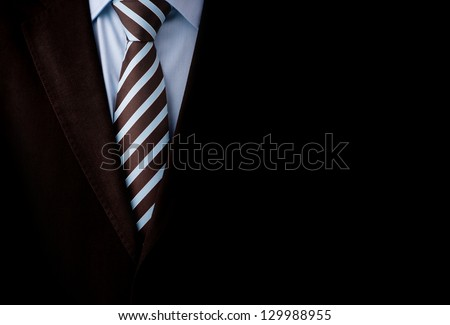 Black business suit with a tie and copyspace background - stock photo