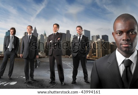 black businessman with a international staff on the background - stock photo