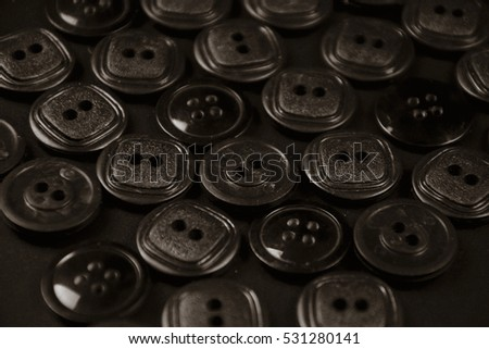 black buttons on black background