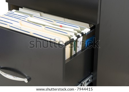 black cabinet  with opened drawer with files in folders - stock photo