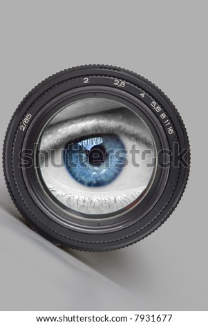 Black camera lens with eye on world - stock photo