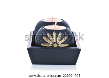 Black candle holder made from wood for spa decoration - stock photo