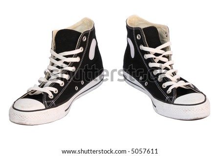 Black canvas sneakers, isolated, clipping path - stock photo