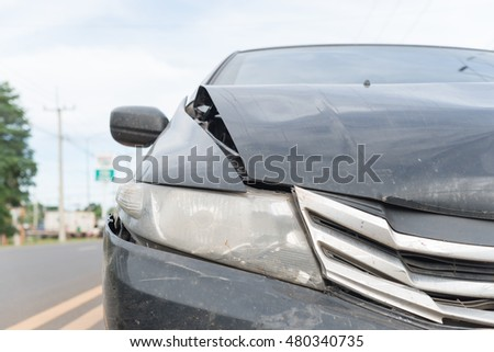 Black car accident side road