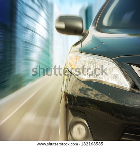 black car driving fast