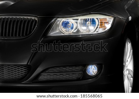 Black car headlights and rim details - stock photo