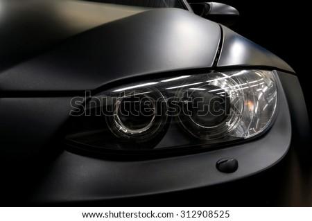 Black car headlights. Exterior detail. - stock photo