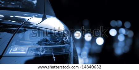 Black car in traffic at night - stock photo