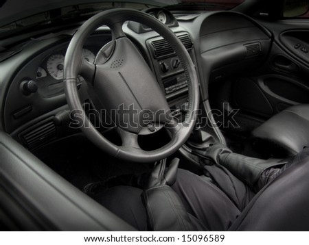 Black car interior with driver - stock photo