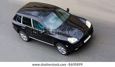 black car on road from top bird's eye view of my cars series - stock photo