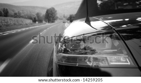 Black car on the highway - stock photo
