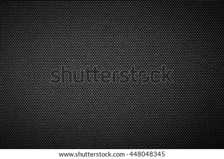 Black Carbon fiber background. Industrial carbon synthetics fabric.