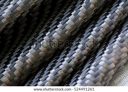 Black carbon fiber composite product material background