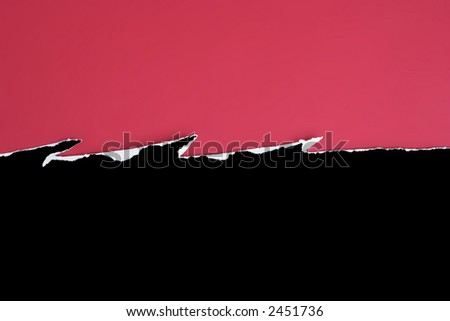 Black card jagged tear on a red background - stock photo