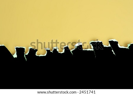 Black card rough jagged tear on a yellow background - stock photo