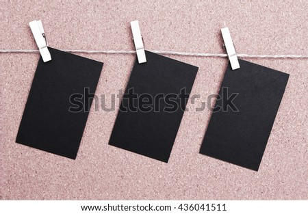 black cards hanged on a nylon thread.  - stock photo