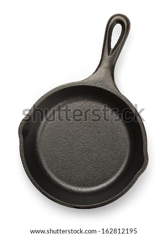Black Cast Iron Pan Isolated on White Background. - stock photo