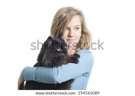 Black cat and blonde woman with blue eyes looking right - stock photo