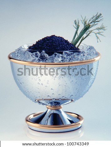 Black caviar in the cup - stock photo