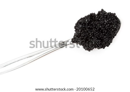 Black caviar on a spoon isolated on white.