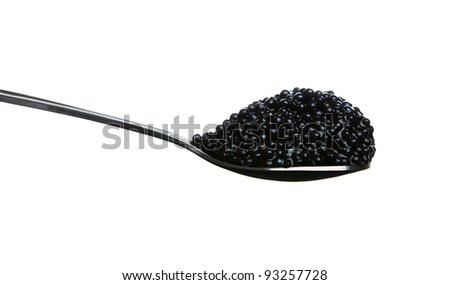 Black caviar on the spoon isolated on white background