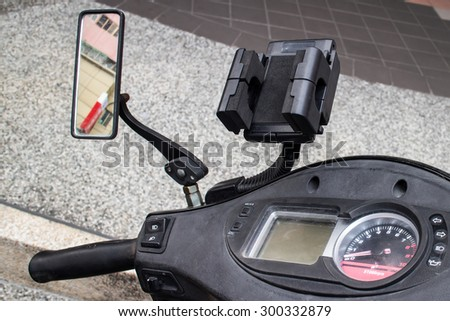 Black cell phone holder fixed on a motorcycle. - stock photo