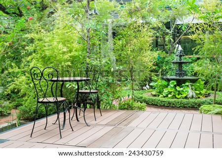 Black chair in the garden for relax - stock photo