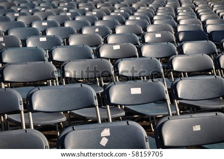 Black Chairs in Stadium for Concert or Sports Game Match - stock photo