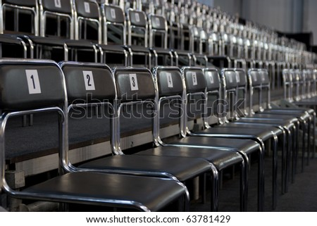 black chairs rows with numbers