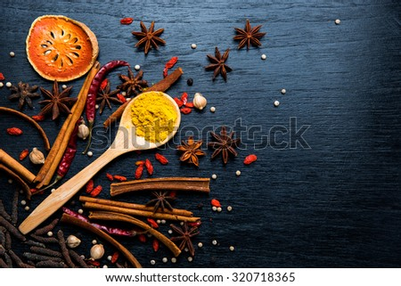 Black chalk board and spices on a dark background, Top view - stock photo