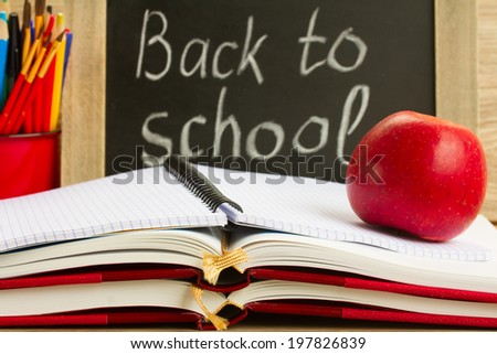 black chalk board with back to school and school supplies - stock photo