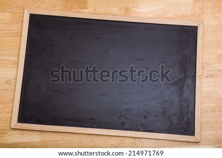 Black chalk board with copy space on desk